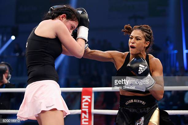 Ikram Kerwat of Germany exchanges punches with Gina Chamie of Hungary during their WBC international lightweight championship title fight at MBS...