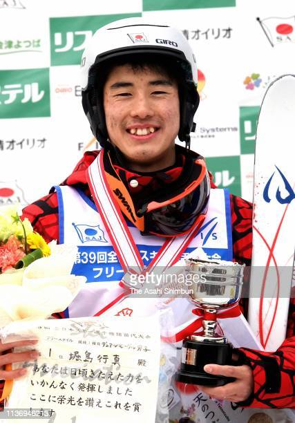 Ikuma Horishima celebrates on the podium at the medal ceremony for the Men's Dual Moguls during the All Japan Freestyle Skiing Championships at the...