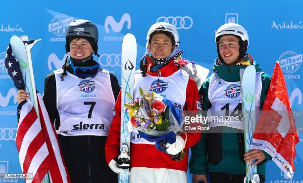 Ikuma Horishima of Japan celebrates winning the gold medal with silver medallist Bradley Wilson of the United States and bronze medallist Marco Tade...