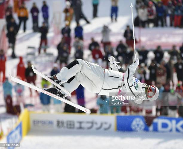 Ikuma Horishima of Japan competes en route to winning the men's moguls at a freestyle skiing World Cup event in Akita Prefecture northeastern Japan...