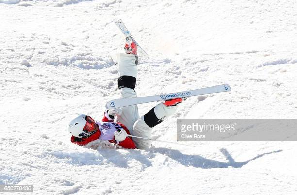 Ikuma Horishima of Japan crashes before going on to win the gold medal in the Men's Dual Moguls on day two of the FIS Freestyle Ski and Snowboard...