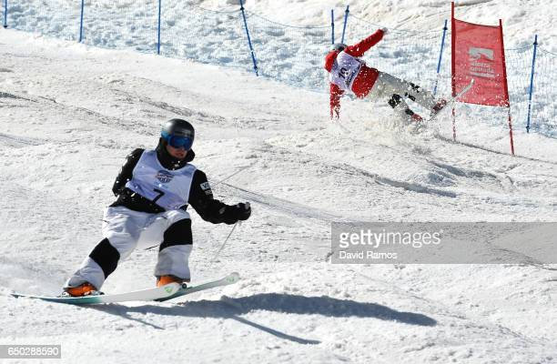 Ikuma Horishima of Japan crashes with Bradley Wilson of the United States before going on to win the gold medal in the Men's Dual Moguls on day two...