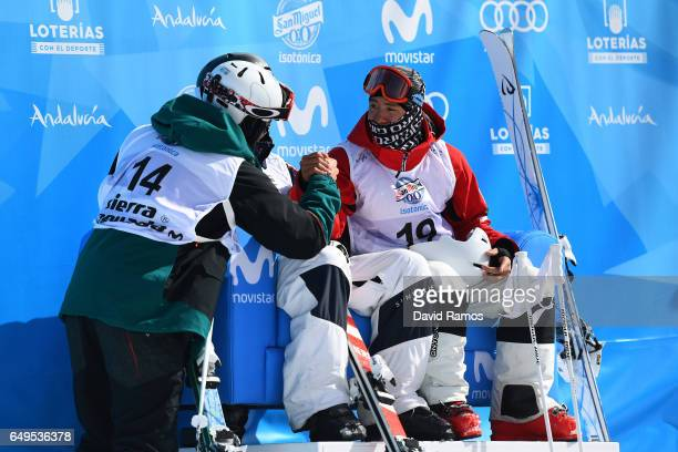 Ikuma Horishima of Japan is congratulated by Marco Tade of Switzerland after winning the gold medal during the Men's Moguls big final on day one of...