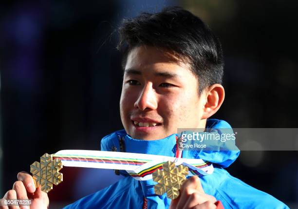 Ikuma Horishima of Japan poses with his two gold medals after the Men's Dual Moguls on day two of the FIS Freestyle Ski and Snowboard World...