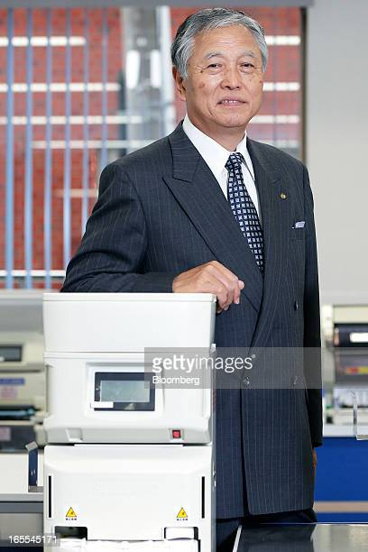 Ikuya Oneda president of Suzumo Machinery Co poses for a photograph with the company's automatic sushi chef machine in Tokyo Japan on Thursday April...