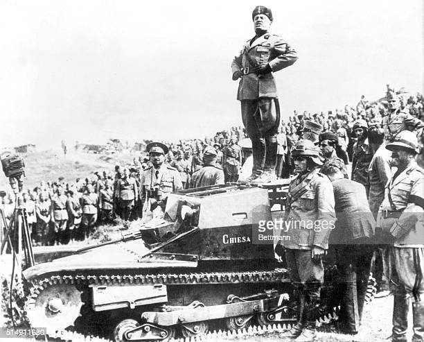 Il Duce stands on a tank to address troops during World War II