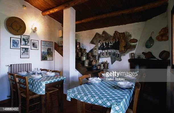 Il Muto di Gallura farm house dining room in Aggius with traditional shepherd mural.