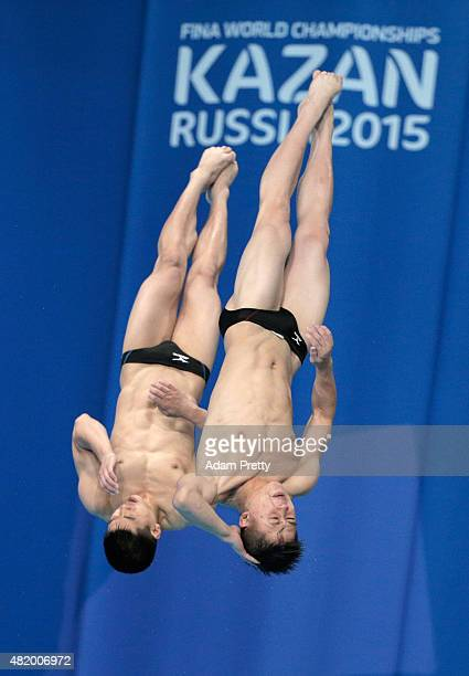 Il Myong Hyon and Sun Bom Kim of Democratic People's Republic of Korea compete in the Men's 10m Platform Synchronised Preliminary Diving on day two...