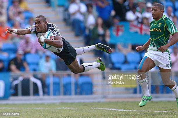 Ilai Tinai of Fiji dives over to score a try during the semi final match between South Africa and Fiji on day two of the 2012 Gold Coast Sevens at...