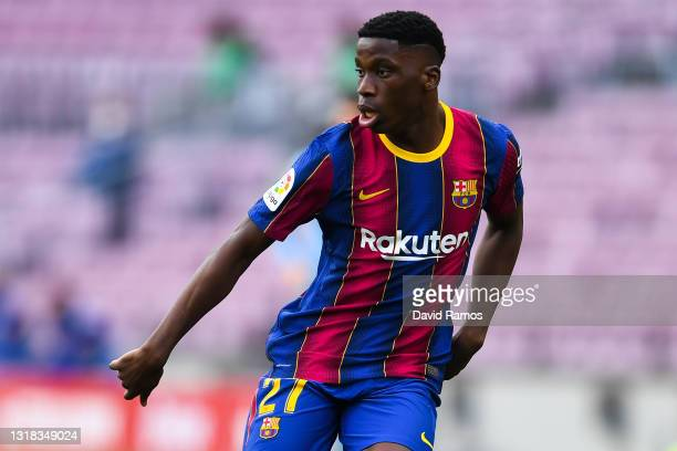 Ilaix Moriba of FC Barcelona looks on during the La Liga Santander match between FC Barcelona and RC Celta at Camp Nou on May 16, 2021 in Barcelona,...
