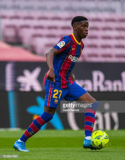 Ilaix Moriba of FC Barcelona runs with the ball during the La Liga Santander match between FC Barcelona and RC Celta at Camp Nou on May 16, 2021 in...