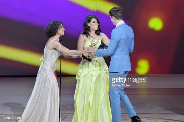 Ilana Glazer Abbi Jacobson and John Mulaney onstage during the 70th Emmy Awards at Microsoft Theater on September 17 2018 in Los Angeles California