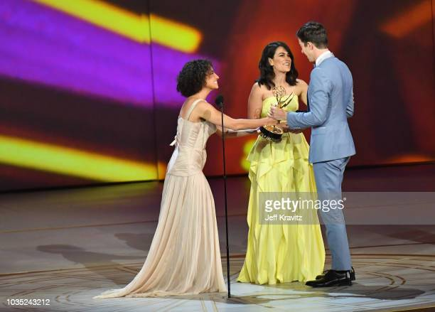 Ilana Glazer and Abbi Jacobson present the award for best writing in a variety special to John Mulaney onstage during the 70th Emmy Awards at...