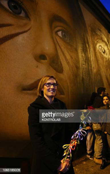 Ilaria Cucchi in front of the wall painting with her portrait made by the artist Jorit Agoch Ilaria Cucchi is the sister of Stefano dead in 2009 in...