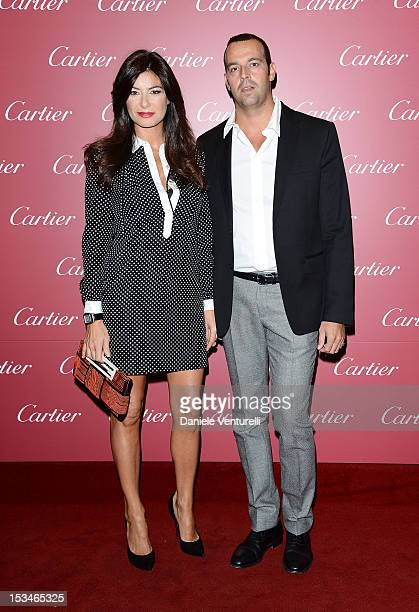 Ilaria d'Amico and Rocco Attisani attend the Cartier Boutique reopening cocktail party on October 5 2012 in Milan Italy