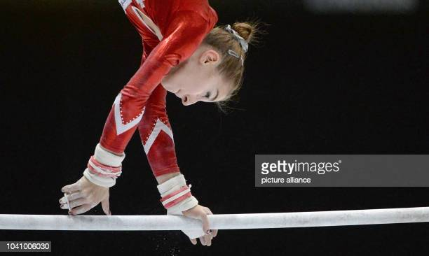 Ilaria Kaeslin of the USA competes at the asymmetric bars during the women's multisport finals at the Artistic Gymnastics World Championships in...
