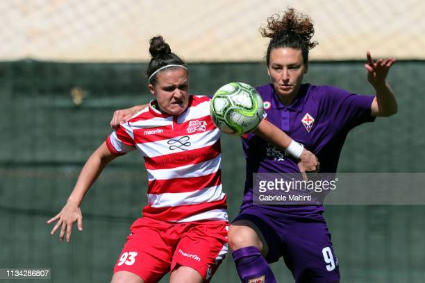 Ilaria Mauro of ACF Fiorentina Women battles for the ball with Lois Jade Roche of Florentia CF Women during the Women Serie A match between ACF...