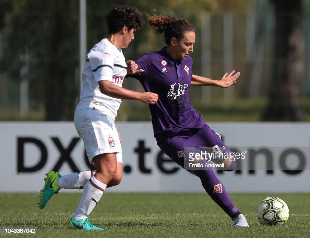 Ilaria Mauro of Fiorentina Women's FC is challenged by Federica Rizza of AC Milan during the Serie A match between AC Milan Women and Fiorentina...