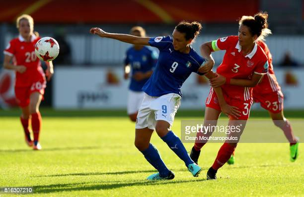 Ilaria Mauro of Italy and Anna Kozhnikova of Russia compete for the ball during the Group B match between Italy and Russia during the UEFA Women's...