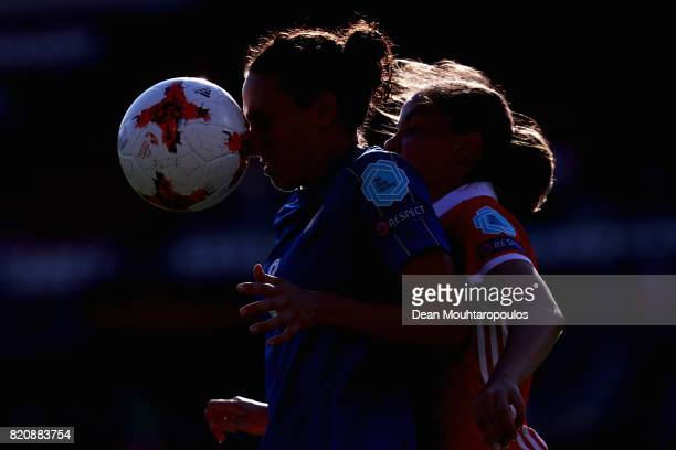 Ilaria Mauro of Italy and Natalya Solodkaya of Russia compete for the ball during the Group B match between Italy and Russia during the UEFA Women's...
