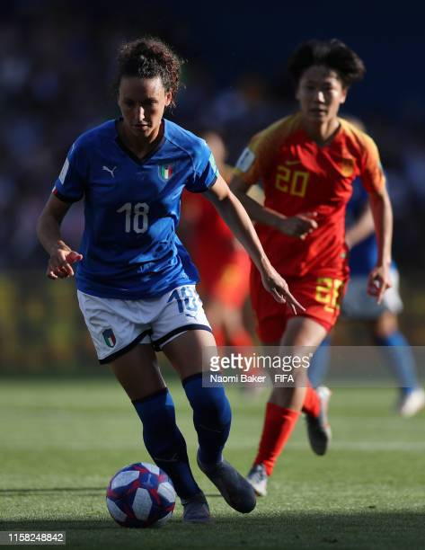 Ilaria Mauro of Italy runs with the ball under pressure from Rui Zhang of China during the 2019 FIFA Women's World Cup France Round Of 16 match...
