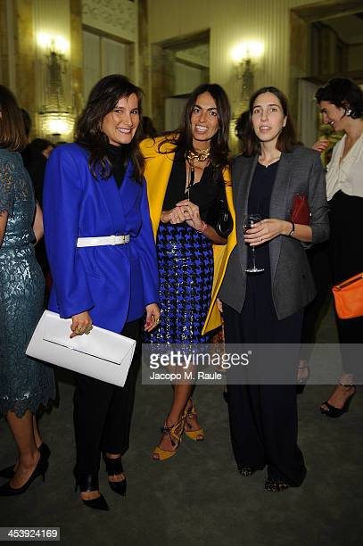 Ilaria Norsa Viviana Volpicella and guest attend Michael Kors to celebrate Milano Cocktail on December 4 2013 in Milan Italy