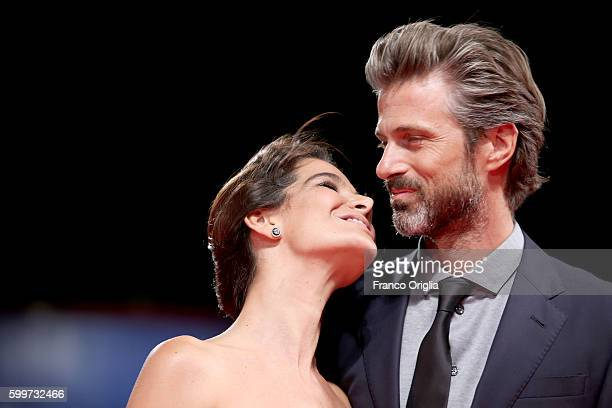 Ilaria Spada and director Kim Rossi Stuart kiss at the premiere of 'Tommaso' during the 73rd Venice Film Festival at Sala Grande on September 6 2016...
