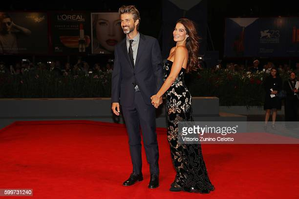 Ilaria Spada and director Kim Rossi Stuart kiss during the premiere of 'Tommaso' during the 73rd Venice Film Festival at Sala Grande on September 6...