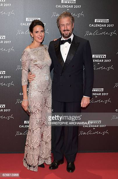 Ilaria Tronchetti Provera daughter of Pirelli's chief executive officer and Anselmo Guerrieri Gonzaga pose during a photocall ahead of a gala dinner...