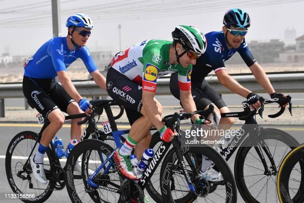 Ildar Arslanov of Rusia and Team GazpromRusvelo / Elia Viviani of Italy and Team DeceuninckQuickStep / Michal Golas of Poland and Team Sky / during...