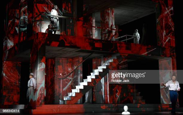 Ildebrando D' Arcangelo as Leporello Willard WWhite as The Commendatore and Mariusz Kwiecien as Don Giovanni with artists of the company in the Royal...