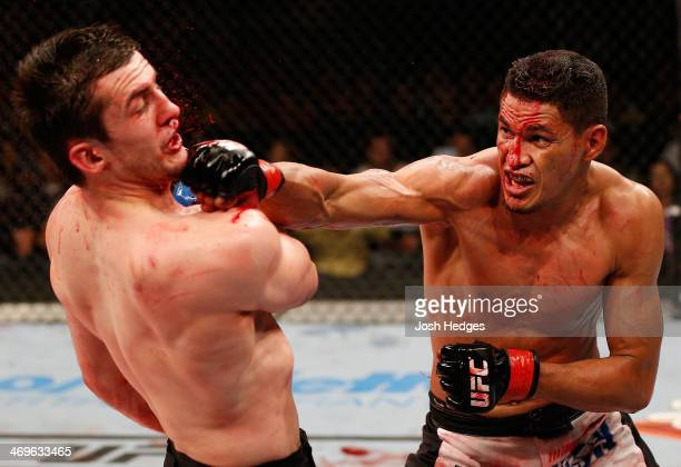 Ildemar Alcantara punches Albert Tumenov in their welterweight fight during the UFC Fight Night event at Arena Jaragua on February 15 2014 in Jaragua...