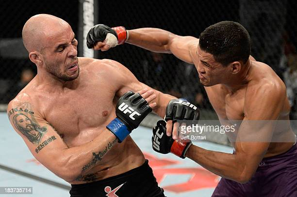 Ildemar Alcantara punches Igor Araujo in their welterweight bout during the UFC Fight Night event at the Ginasio Jose Correa on October 9, 2013 in...