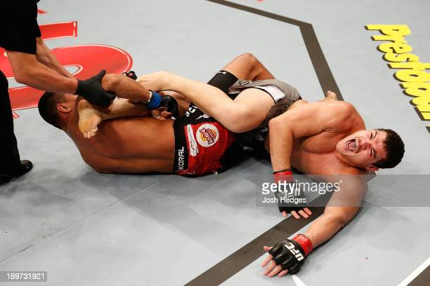 Ildemar Alcantara secures a knee bar submission against Wagner Prado in their light heavyweight fight at the UFC on FX event on January 19, 2013 at...