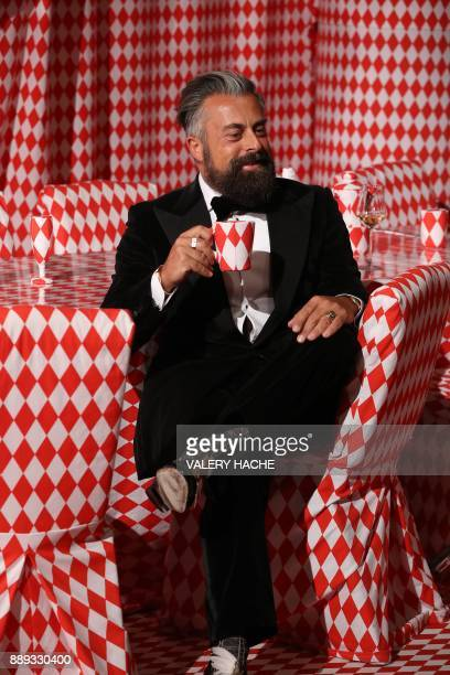 Ildo Damiano poses for pictures in the Atrium lobby of the Monte Carlo Casino decorated under the theme 'Let's fall in Diamonds' by the artist as he...