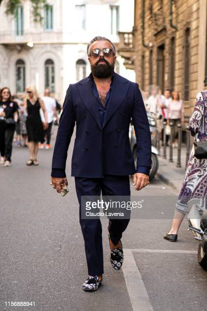 Ildo Damiano wearing a blue suit blue shirt and printed loafers is seen outside Giorgio Armani show during the Milan Men's Fashion Week Spring/Summer...