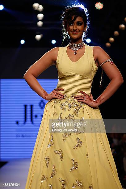 Ileana D'Cruz walks the runway at the Jewels by Preeti show during Day 4 of the India International Jewellery Week at the Grand Hyatt on August 6...