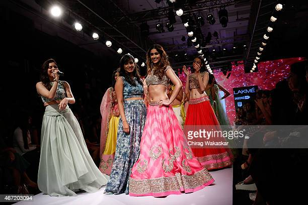 Ileana D'Cruz walks the runway with Anrushree Reddy on day 4 of Lakme Fashion Week Summer/Resort 2015 at Palladium Hotel on March 21 2015 in Mumbai...