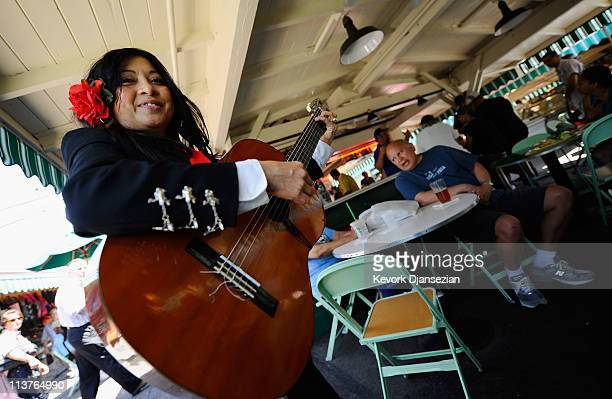 Ileana Garcia vocalist for the allfemale strolling Mariachi band Ellas Son performs at Los Angeles Farmer Market during Cinco de Mayo festivities on...