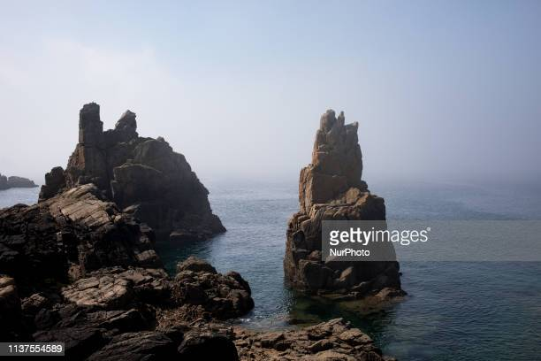 Ile-de-Brehat, Brittany, France, March 30, 2019. The pink granite coast on the island of Brehat. Nicknamed the Flower Island, the archipelago...
