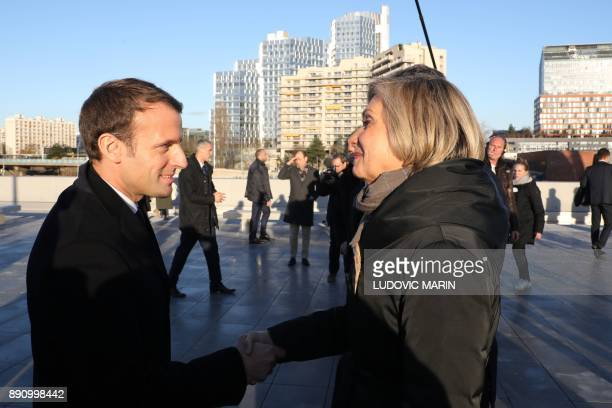 IledeFrance region president Valerie Pecresse shakes hands with French President Emmanuel Macron during the Plenary Session of the One Planet Summit...