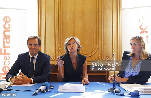 Ile-de-France regional council president Valerie Pecresse speaks, alongside Ile-de-France vice president in charge of the economy and employment...