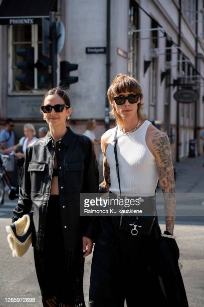 Ilenia Thoma wearing black knitted skirt black bikini top black leather shirt and beige fur bag and Simon Nygard wearing white tshirt and black...