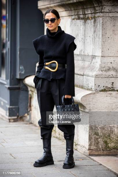 Ilenia Toma wearing a black jumper gold belt black pants Bottega Veneta boots and Dior bag is seen outside the Unravel show during Paris Fashion Week...