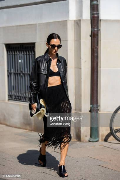 Ilenia Toma wearing black button shirt, skirt with fringes outside MFPEN during Copenhagen Fashion Week Spring/Summer 2021 on August 12, 2020 in...