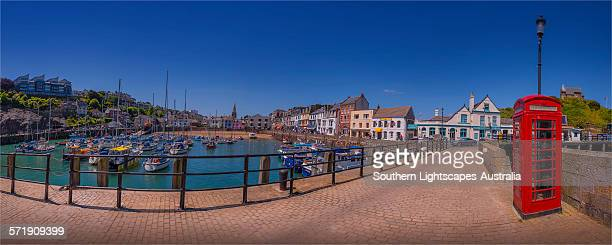 ilfracombe wharf and phone booth - ilfracombe stock photos and pictures