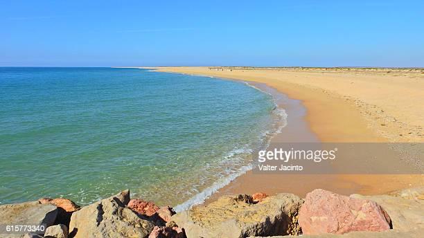 ilha deserta beach, algarve, portugal - faro stock pictures, royalty-free photos & images
