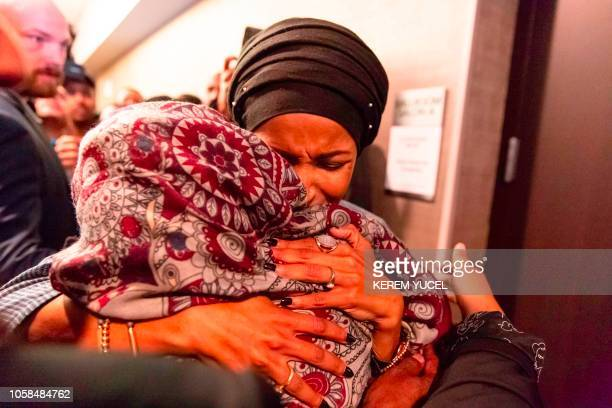 TOPSHOT Ilhan Omar newly elected to the US House of Representatives on the Democratic ticket celebrates with her supporters after...