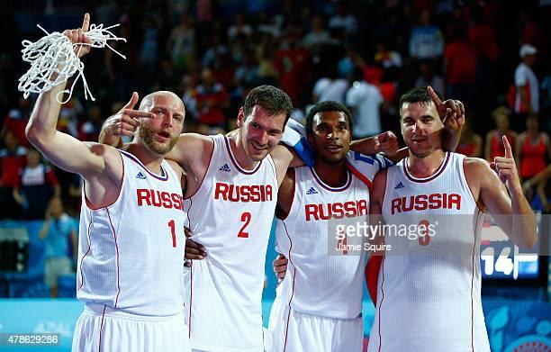 Ilia Aleksandrov Aleksandr Pavlov Leopold Lagutin and Andrey Kanygin of Russia celebrate winning gold after the Men's 3x3 Basketball gold medal match...