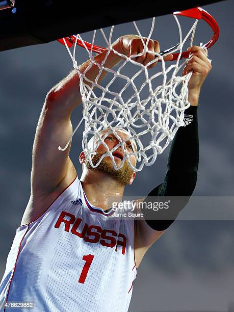 Ilia Aleksandrov of Russia cuts down the net in celebration after winning gold in the Men's 3x3 Basketball gold medal match between Russia and Spain...